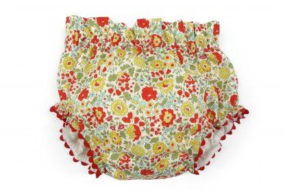 Vista frontal culotte liberty estampado flores rojo, verde y amarillo. Modelo Scarlett.