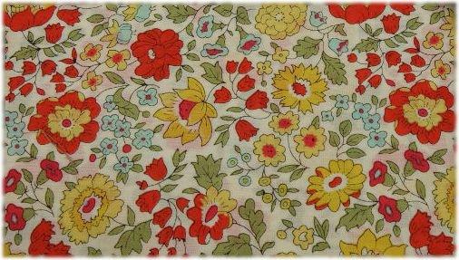 Tela liberty con flores rojas y amarillas